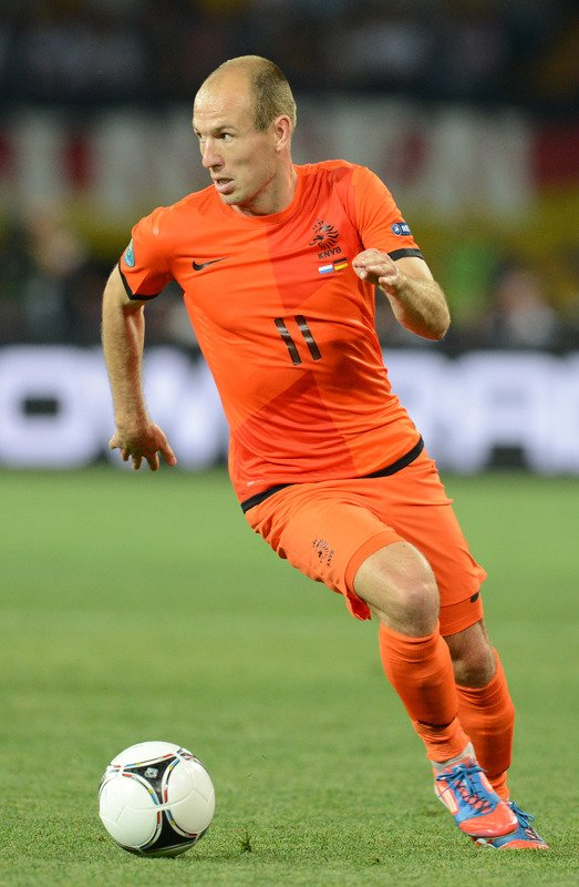 Dutch Midfielder Arjen Robben Runs AFP/Getty Images