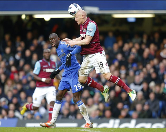 Ba of Chelsea watches as Collins of West Ham heads the ball during their English Premier League match in London
