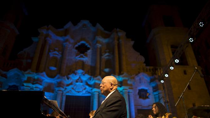 Cuban pianist and Grammy winner Chucho Valdes performs during a concert at the Cathedral Square in Havana