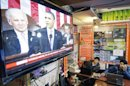 Afghan men watch a television news report on U.S. President Barack Obama's State of the Union address in Kabul, Afghanistan Wednesday, Feb. 13, 2013. President Obama announced plans to withdraw more troops from Afghanistan and take steps to boost the fragile U.S. economy as he delivered a closely watched State of the Union address laying out his priorities for the year and for his newly begun second term in office. (AP Photo/Musadeq Sadeq)
