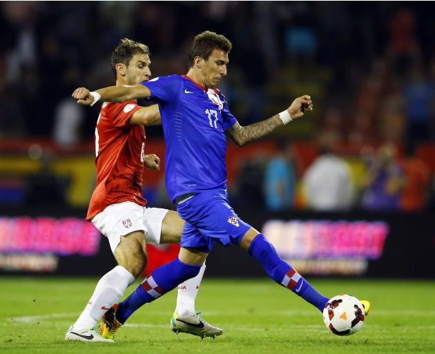 Croatia's Mandzukic challenges Serbia's Ivanovic during their 2014 World Cup qualifying soccer match in Belgrade