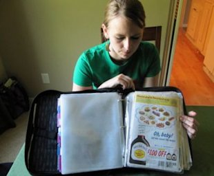 Monica Knight, a dental hygienist and mother of two, shows her coupon binder at her home in Boise, Idaho. Knight, a used to spend spent $600 a month on groceries. Thanks to extreme couponing she's down to $100-150 a month. (AP Photo/Jessie L. Bonner)