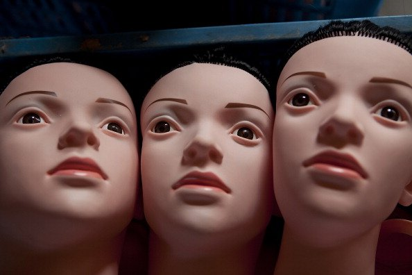 NINGBO, CHINA - FEBRUARY 19: (CHINA OUT) Three unfinished sex dolls are stored at the Jiamei Plastic Toy Factory on February 19, 2012 in Ningbo, China. The Jiamei plastic toy company, based in the sub