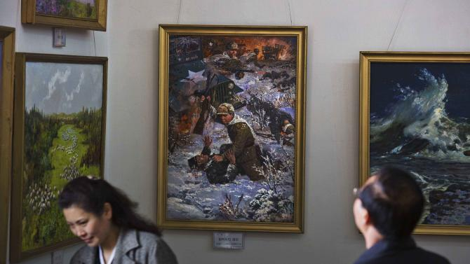 A painting, depicting North Korean soldiers ambushing and killing U.S. troops, hangs on a gallery wall at an art exhibition in Pyongyang, North Korea on Friday April 19, 2013. (AP Photo/David Guttenfelder)