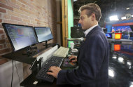 In this photo taken Aug. 2, 2012, TV meteorologist Todd Yakoubian makes a last-minute check of maps before going on the air for a weather report at KATV Television studios in Little Rock, Ark. (AP Photo/Danny Johnston)