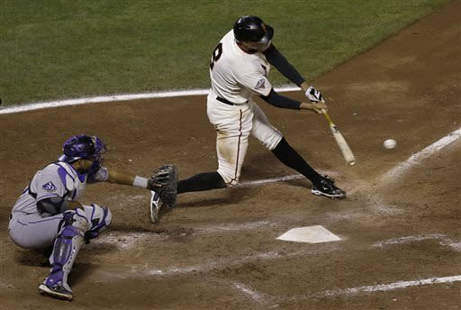 Giants rally past Rockies 9-6 to bail out Lincecum