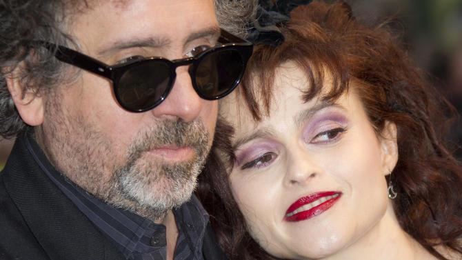 "FILE  This Wednesday, May 9, 2012 file photo shows film director Tim Burton and wife Helena Bonham Carter as they arrive for the UK Premiere of 'Dark Shadows', at a central London cinema. Britain's biggest film showcase opens Wednesday Oct. 10, 2012 with the European premiere of London-based American director Tim Burton's ""Frankenweenie,"" the animated tale of a boy and his beloved _ but dead _ dog. It ends Oct. 21 with Mike Newell's adaptation of Charles Dickens' ""Great Expectations,"" which stars Burton's real-life partner, Helena Bonham Carter, as haunted Miss Havisham. Festival director Clare Stewart said she was happy to be ""bracketing the festival with one of London's great love affairs"" _ the ghoul-loving filmmaker and his gothic muse. (AP Photo/Joel Ryan)"