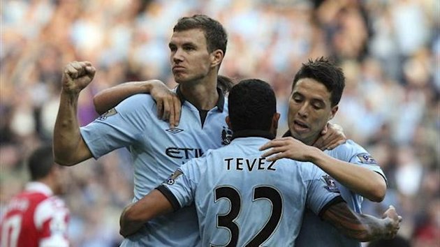 Dzeko, Tevez and Nasri celebrating a goal