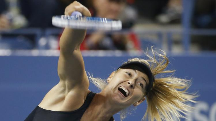 Maria Sharapova of Russia serves to Sabine Lisicki of Germany in their women's singles play during their match at the 2014 U.S. Open tennis tournament in New York