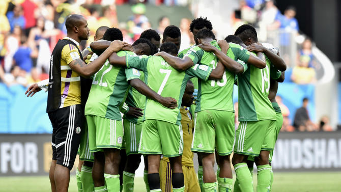 Nigeria players form a team huddle after the World Cup round of 16 soccer match between France and Nigeria at the Estadio Nacional in Brasilia, Brazil, Monday, June 30, 2014. France won the match 2-0. (AP Photo/Martin Meissner)