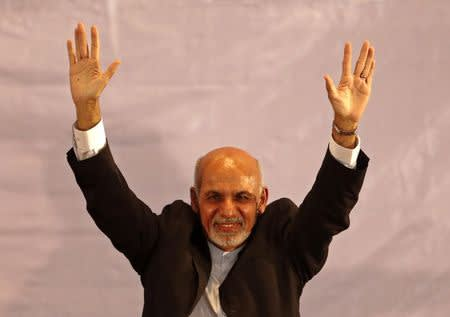 Afghan president-elect Ashraf Ghani Ahmadzai waves as he participates an event in Kabul
