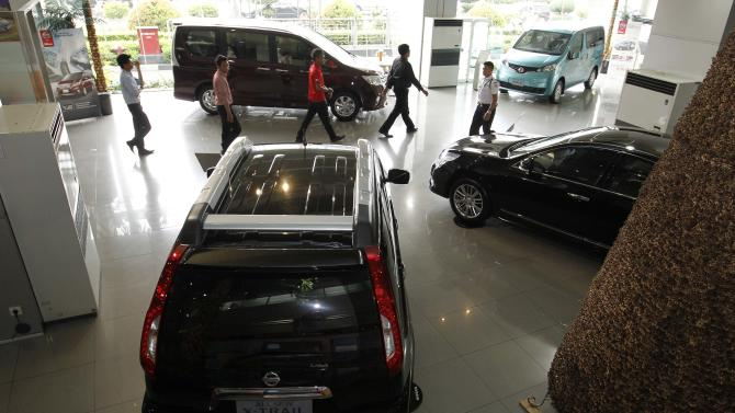 Nissan vehicles are seen in a Nissan dealership in Jakarta