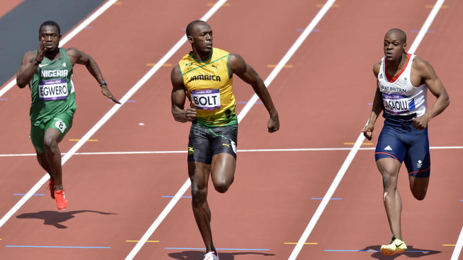 Nigeria's Ogho-Oghene Egwero, left, Jamaica's Usain Bolt, center, and Britain's James Dasaolu compete in a men's 100-meter heat during the athletics in the Olympic Stadium at the 2012 Summer Olympics, London, Saturday, Aug. 4, 2012. (AP Photo/Martin Meissner)