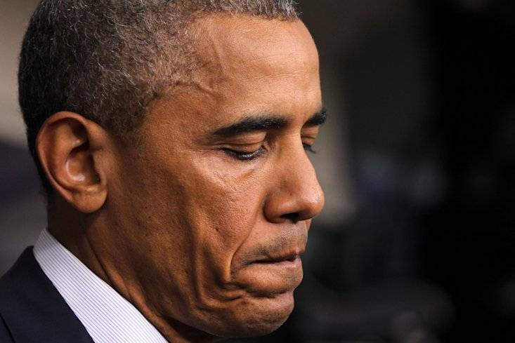 President Barack Obama pauses as he speaks in the Brady Press Briefing Room of the White House in Washington, Friday, Aug. 1, 2014. (AP Photo/Connor R...