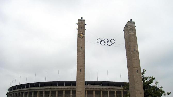 This Sept. 25, 2010 photo shows the Olympic rings on the approach to Olympiastadion Berlin, where U.S. gold medalist Jesse Owens won four gold medals during the 1936 Summer Olympics in Berlin, Germany. Germany hosted two notorious games: The 1936 Berlin Olympics, which Adolf Hitler tried to turn into a showcase of Aryan supremacy, and the 1972 Munich Olympics, married by a hostage crisis that left 11 Israelis dead. A tour takes you to the stands overlooking the track area where Owens and other athletes competed. (AP Photo/Anick Jesdanun)