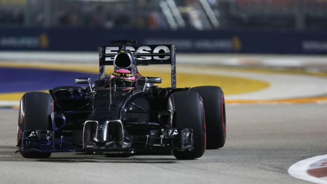 McLaren Formula One driver Jenson Button of Britain drives during the second practice session of the Singapore F1 Grand Prix at the Marina Bay street circuit in Singapore