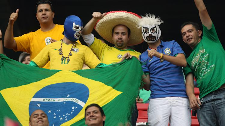 Brazil's fans cheer before a men's soccer match against Argentina at the Pan American Games in Guadalajara, Mexico, Wednesday, Oct. 19, 2011. (AP Photo/Juan Karita)