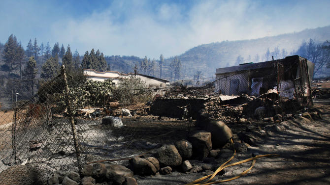 FILE - In this Monday, Aug. 6, 2012 file photo, a scorched and burnt farm appears after the ravages of a wildfire which swept through parts La Gomera, the Canary Islands, Spain. Wildfires spurred by high temperatures raged across Spain's Canary Islands of La Gomera and Tenerife as well as Ourense in northwestern Spain on Saturday, Aug. 11, 2012. Flames are threatening some of Europe's oldest surviving forests in La Gomera and have forced the evacuation of hundreds of people across the country. (AP Photo/Moises Mendoza, File)
