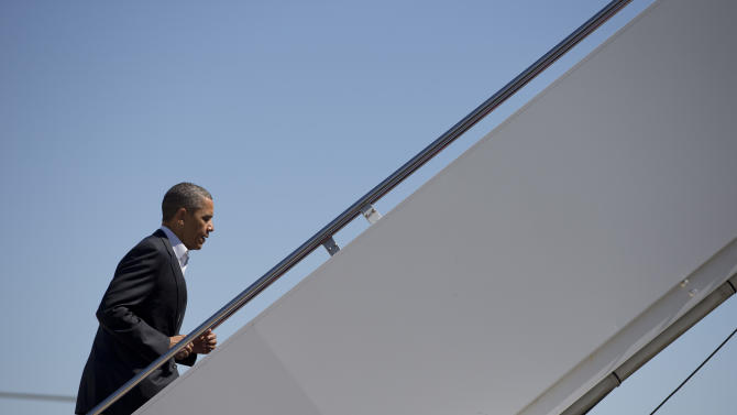 President Barack Obama boards Air Force One, Sunday, May 26, 2013, at Andrews Air Force Base, Md., en route to Moore, Okla., to visit with families and first responders in the wake of the tornadoes and severe weather that devastated the area. (AP Photo/Carolyn Kaster)