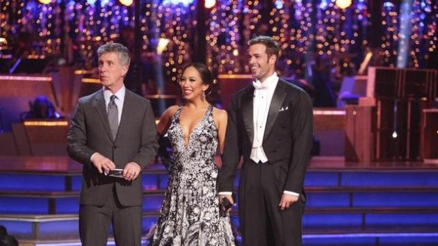 Tom Bergeron, Cheryl Burke and WIlliam Levy try to hear the judges over the roar of the crowd during Week of 'Dancing with the Stars,' May 7, 2012 -- ABC