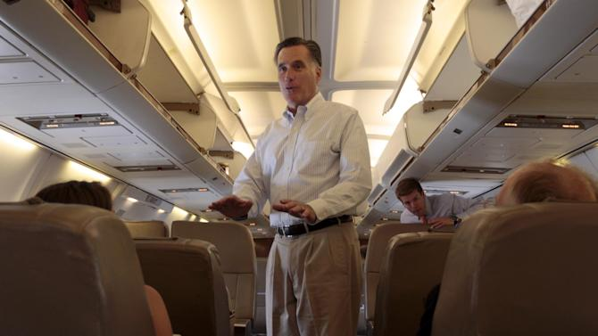 Republican presidential candidate, former Massachusetts Gov. Mitt Romney speaks to reporters after boarding the charter airplane, Wednesday, May 16, 2012, in Tampa, Fla. (AP Photo/Mary Altaffer)