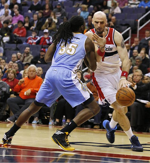 Washington Wizards center Marcin Gortat (4), from Poland, cannot get past Denver Nuggets forward Kenneth Faried (35) in the second half of an NBA basketball game Monday, Dec. 9, 2013, in Washington. T