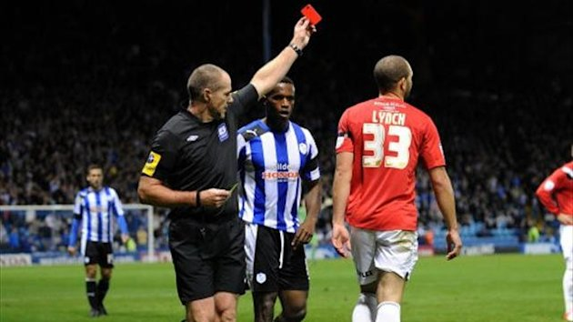 Referee shows a red card to Huddersfield Town's Joel Lynch at Sheffield Wednesday
