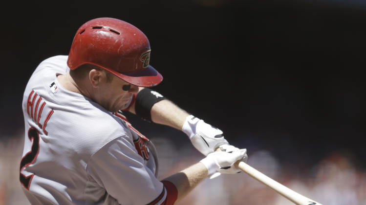 Arizona Diamondbacks' Aaron Hill swings for a double off San Francisco Giants' Ryan Vogelsong in the seventh inning of a baseball game Saturday, July 12, 2014, in San Francisco. (AP Photo/Ben Margot)