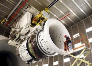 General Electric employee Brian Kirk prepares a jet engine at the GE Aviation Peebles Test Operations Facility in Peebles, Ohio