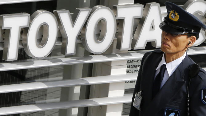 A security officer walks round a Toyota showroom in Tokyo, Tuesday, Feb. 5, 2013.  Toyota Motor Corp. reported its October-December profit rose 23 percent to 99.91 billion yen ($1.09 billion), compared to the same period the previous year, as sales jumped, especially in the U.S. Toyota also raised its projections Tuesday for the fiscal year through March.  (AP Photo/Koji Sasahara)