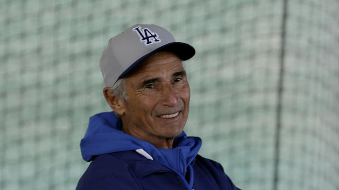 Los Angeles Dodgers Hall of Fame pitcher Sandy Koufax watches workouts during spring training baseball in Phoenix, Wednesday, Feb. 20, 2013.  (AP Photo/Paul Sancya)