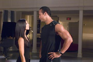 Roselyn Sanchez and Dwayne 'The Rock' Johnson in Walt Disney Pictures' The Game Plan