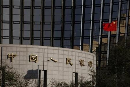 China's nation flag flies in front of the headquarters of the People's Bank of China, the central bank, in Beijing