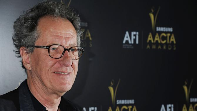 """This Jan. 27, 2012 photo shows Geoffrey Rush arriving at The Australian Academy of Cinema and Television Arts Awards at the Soho House, in Los Angeles.  Rush,  who played speech therapist Lionel Logue in the Oscar-winning film """"The King's Speech""""  has repeatedly said he first found the script left in brown paper wrapping on his Australia home's doorstep. Now, he says he wishes he had kept that story to himself. Rush says other aspiring filmmakers have followed suit, leaving all manner of projects at his front door in Melbourne since the movie first came out in 2010. As he puts it: """"The brown paper package phenomenon continues."""" (AP Photo/Katy Winn)"""