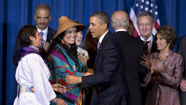 President Barack Obama greets Our Sister's Keeper Executive Director Diane Millich, from left, and Tulalip Tribes of Washington State Vice Chairwoman Deborah Parker, after signing the Violence Against Women Act , Thursday, March 7, 2013, at the Interior Department in Washington.  (AP Photo/Manuel Balce Ceneta)