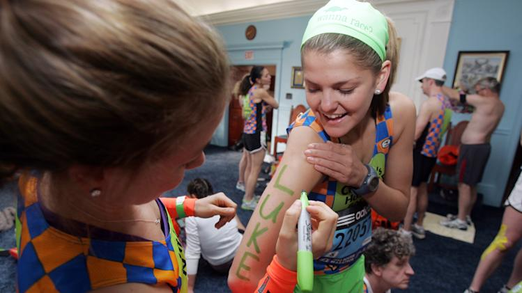 COMMERCIAL IMAGE - In this photo taken by AP Images for Children's Hospital Boston, Beth Millian, a Miles for Miracles Team member, sharpies-up before running the 116th Boston Marathon on Monday, April 16, 2012 in Hopkinton, Massachusetts. (Aynsley Floyd/AP Images for Children's Hospital Boston)