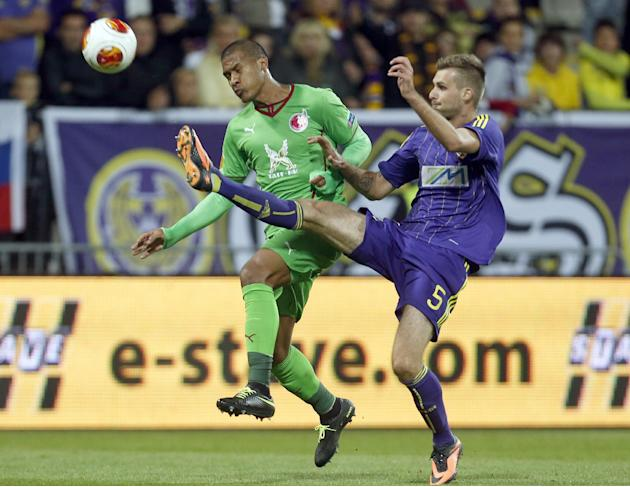 Rubin Kazan's Jose Rondon, left, is challenged by Maribor's Zeljko Filipovic, during their group D Europa League soccer match, in Maribor, Slovenia, Thursday, Sept. 19, 2013