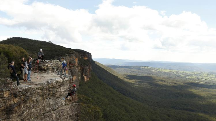 Britain's Prince William and his wife Catherine, the Duchess of Cambridge, visit the Narrow Neck Lookout and observe abseiling by the Mountain Youth Services group in the Blue Mountains town of Katoomba
