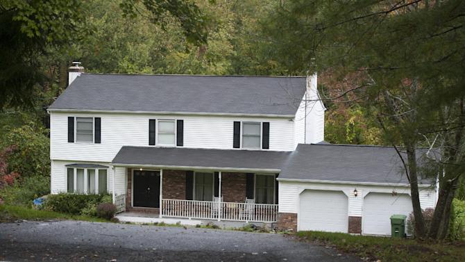 The residence of Alexis Scocozza at 7 Meetinghouse Hill Circle is seen in New Fairfield, Conn., Friday, Sept. 28, 2012.  Scocozza's brother and next door neighbor, Jeffery Giuliano, fatally shot a masked teenager in self-defense during what appeared to be an attempted burglary early Thursday morning, then discovered that he had killed his son, state police said.  (AP Photo/Jessica Hill)