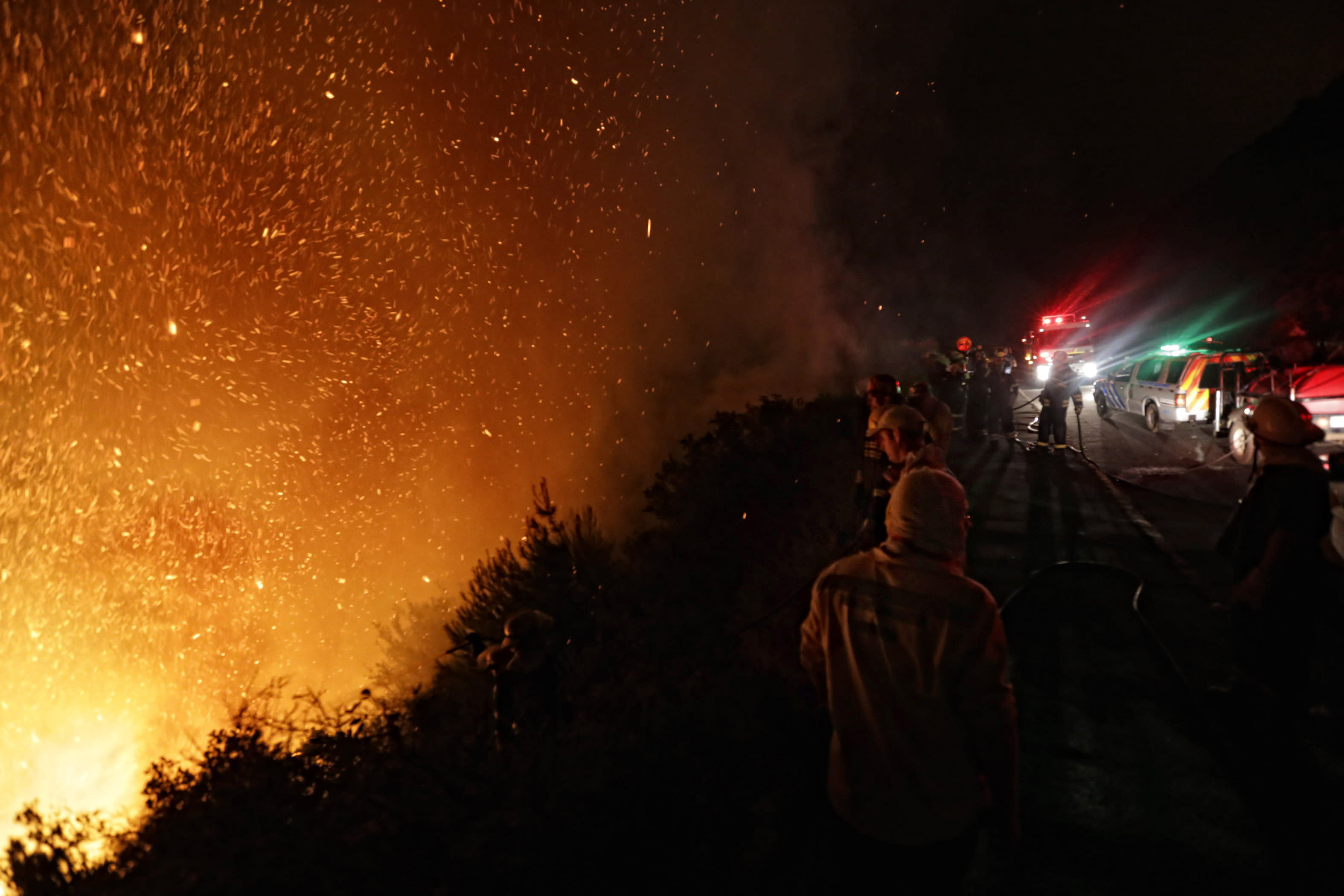 Hundreds evacuated as wildfire in South Africa burns on