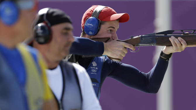 Great Britain's Peter Wilson shoots, as competitors look on, during the final of the men's double trap, at the 2012 Summer Olympics, Thursday, Aug. 2, 2012, in London. Wilson won gold in the event. (AP Photo/Rebecca Blackwell)