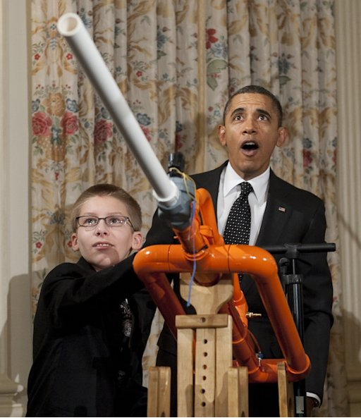 US President Barack Obama reacts as 14-year-old Joey Hudy of Phoenix, Arizona, launches a marshmallow