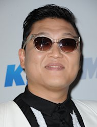 FILE - In this Monday, Dec. 3, 2012 file photo, PSY arrives at KIIS FM&#39;s Jingle Ball at Nokia Theatre LA Live, in Los Angeles. President Barack Obama still intends to attend a charity concert where PSY is scheduled to perform after reports the South Korean rapper participated in anti-American protests several years ago. (Photo by Katy Winn/Invision/AP, File)