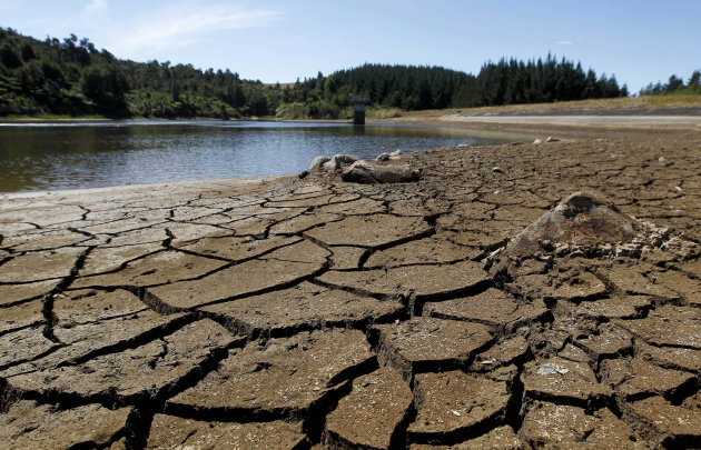 This photo from Feb. 26, 2013 shows dry cracked land near a water reservoir in Kiwitahi, New Zealand. A drought in New Zealand's North Island is costing farmers millions of dollars each day and is beg