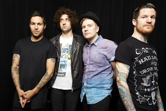 "This April 12, 2013 photo shows members of the band Fall Out Boy, from left,Pete Wentz, Joe Trohman, Patrick Sump and Andy Hurley in New York. Fall Out Boy's new album, ""Save Rock and Roll,"" released"