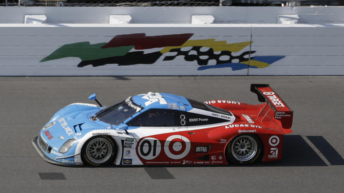 Scott Pruett drives the Ganassi Racing BMW Riley as he maintains the lead during the final hours of the Grand-Am Series Rolex 24 hour auto race at Daytona International Speedway, Sunday, Jan. 27, 2013, in Daytona Beach, Fla. (AP Photo/John Raoux)