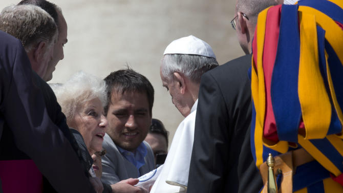 """Leader of the Grandmothers of the Plaza de Mayo Estela do Carlotto, left, and Juan Cabandie, a recovered grandson, center, meet with Pope Francis at the end of his weekly general audience in St. Peter's Square at the Vatican, Wednesday April 24, 2013. Representatives from """"Grandmothers of Plaza de Mayo,"""" an activist group that searches for people missing from Argentina's """"dirty war,"""" attended Pope Francis' general audience and said they will ask him to open the church files on the country's wartime era. The former Cardinal Jorge Mario Bergoglio was the head of the Jesuit order in Argentina during the start of the 1976-82 dictatorship that kidnapped and killed thousands of people to eliminate leftist opponents. (AP Photo/Alessandra Tarantino)"""