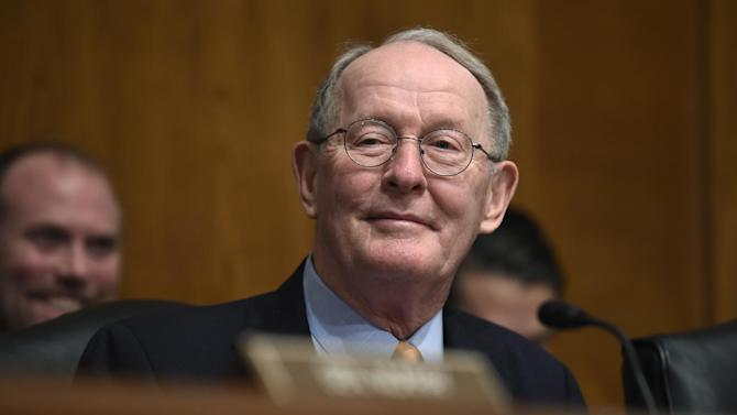 FILE - In this Jan. 21, 2015 file photo, Senate Health, Education, Labor and Pensions Committee Chairman Sen. Lamar Alexander, R-Tenn. listens to testimony on Capitol Hill in Washington. It's something most everyone on both sides of the aisle can agree on _ an update to the Bush-era No Child Left Behind education law is much needed and long overdue. This week, the Senate and House take up rewrites of the 2002 law, with lawmakers seeking to finally resolve a key question Congress has struggled with for many years (AP Photo/Susan Walsh, File)