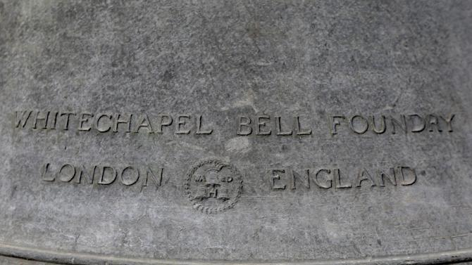 Shown is the inscription on the back of the Bicentennial Bell before it is lifted it to a shipping container, Thursday, Jan. 31, 2013, in Philadelphia. The bell made in the same British foundry as its twin of the iconic Liberty Bell was a 1976 Bicentennial gift from from England and was presented by Queen Elizabeth II to the city.  The bell tower and its accompanying building, constructed for the 1976 Bicentennial, are being demolished to make way for a Revolutionary War museum.  (AP Photo/Matt Rourke)