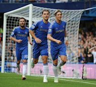 Chelsea's Fernando Torres (R) celebrates scoring a goal with teammates Branislav Ivanovic (2nd L) and Juan Mata during their English Premier League match vs Newcastle United at Stamford Bridge in London, on August 25. Table-toppers Chelsea, the Champions League holders, make the short journey to local rivals QPR next, on Saturday